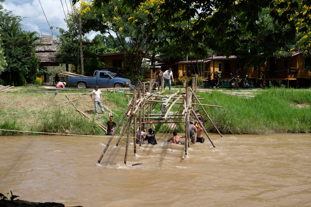 These guys threw themselves around on the bamboo structure like they were monkeys, all whilst the water was rushing around and below them!