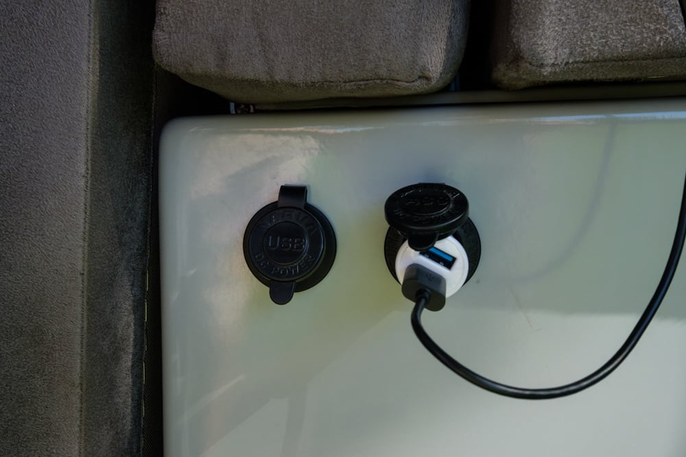 Sockets under the bench seat, left is USB, right is cigarette lighter