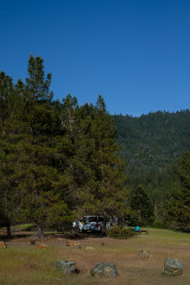 Our van hiding in the trees, with the river to the right and the bear bin to my left